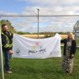 RM of St. Clements Public Works Lead Hand Darren Otto and Mayor Debbie Fiebelkorn with the Rotary Peace Flag
